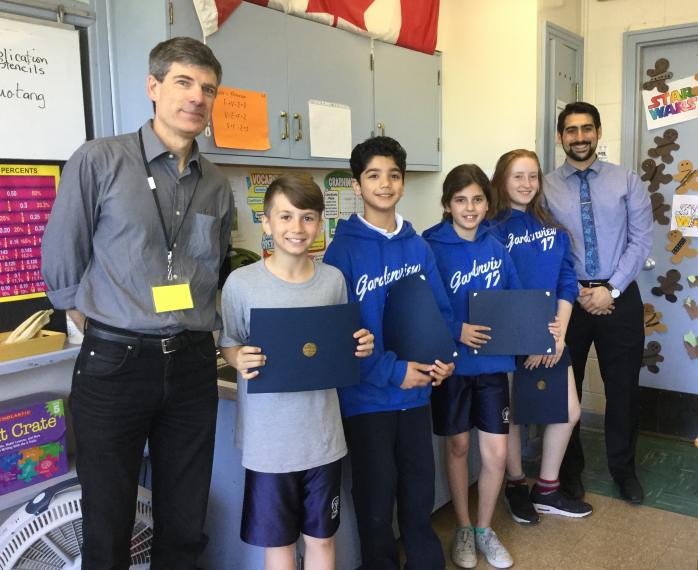 Quebec Heritage News Editor Rod MacLeod stopped by Gardenview Elementary School in Saint-Laurent this week to present the kids in teacher Nina Wong's Grade 6 class with their certificates for winning 1st, 2nd, 3rd Prize and Honourable Mention in QAHN's 2016-2017 Heritage Essay Contest. Seen here (L to R): Rod MacLeod; Luca, Abdul, Zoe, and Emilia; and Gardenview VP Gaetano Sifoni. (Photo - Nina Wong)